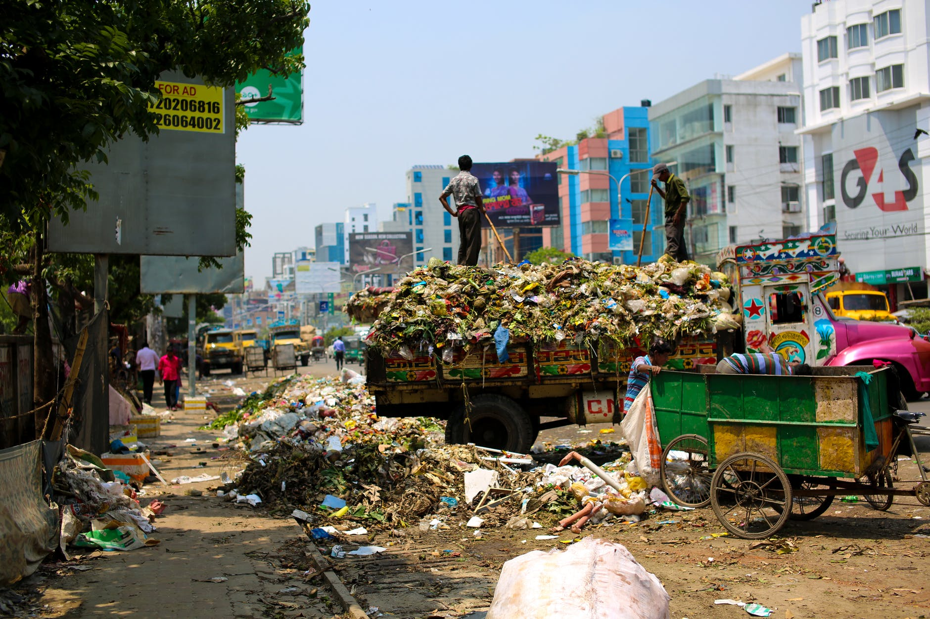 photo of a dump truck across buildings