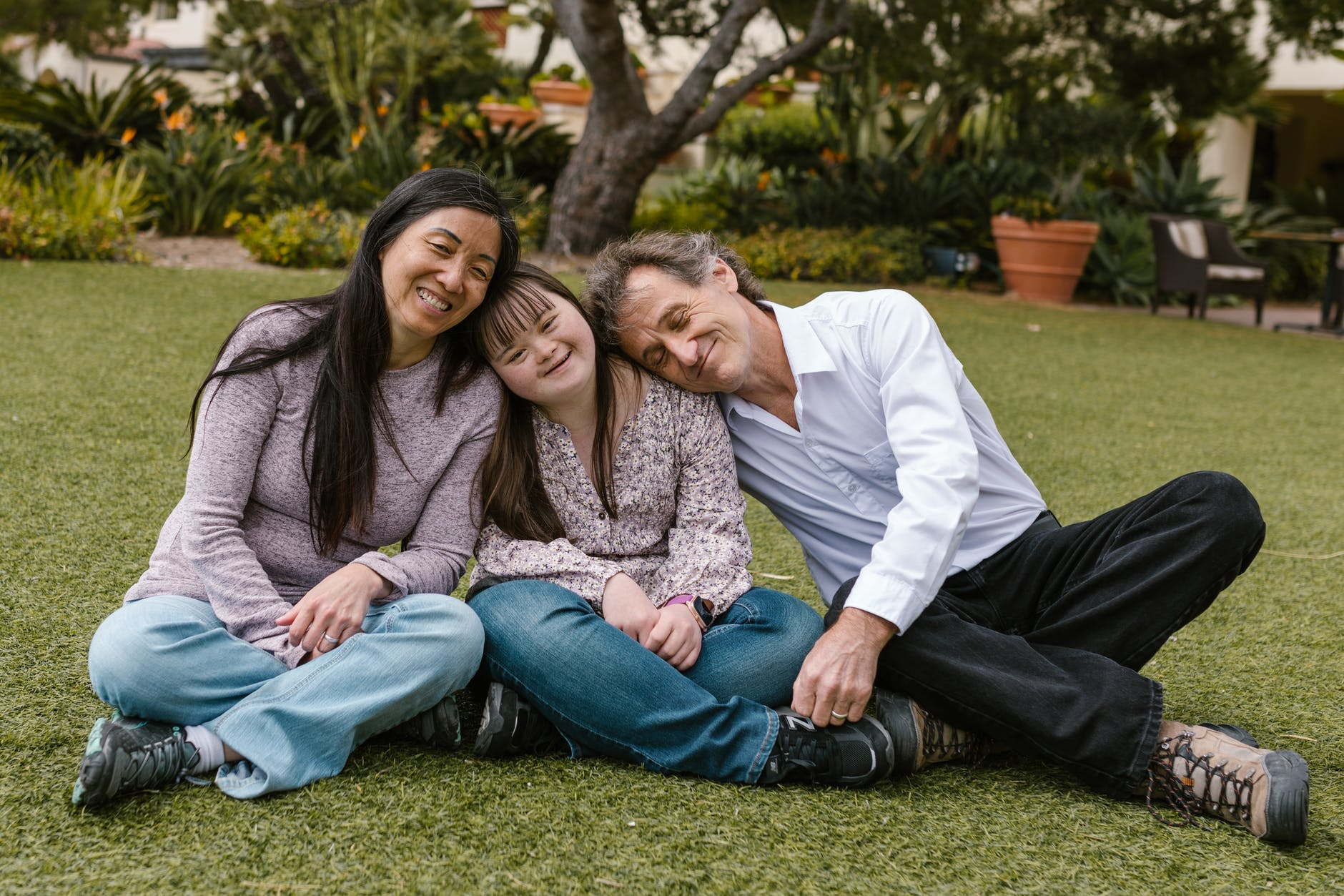 a happy family sitting on the grass