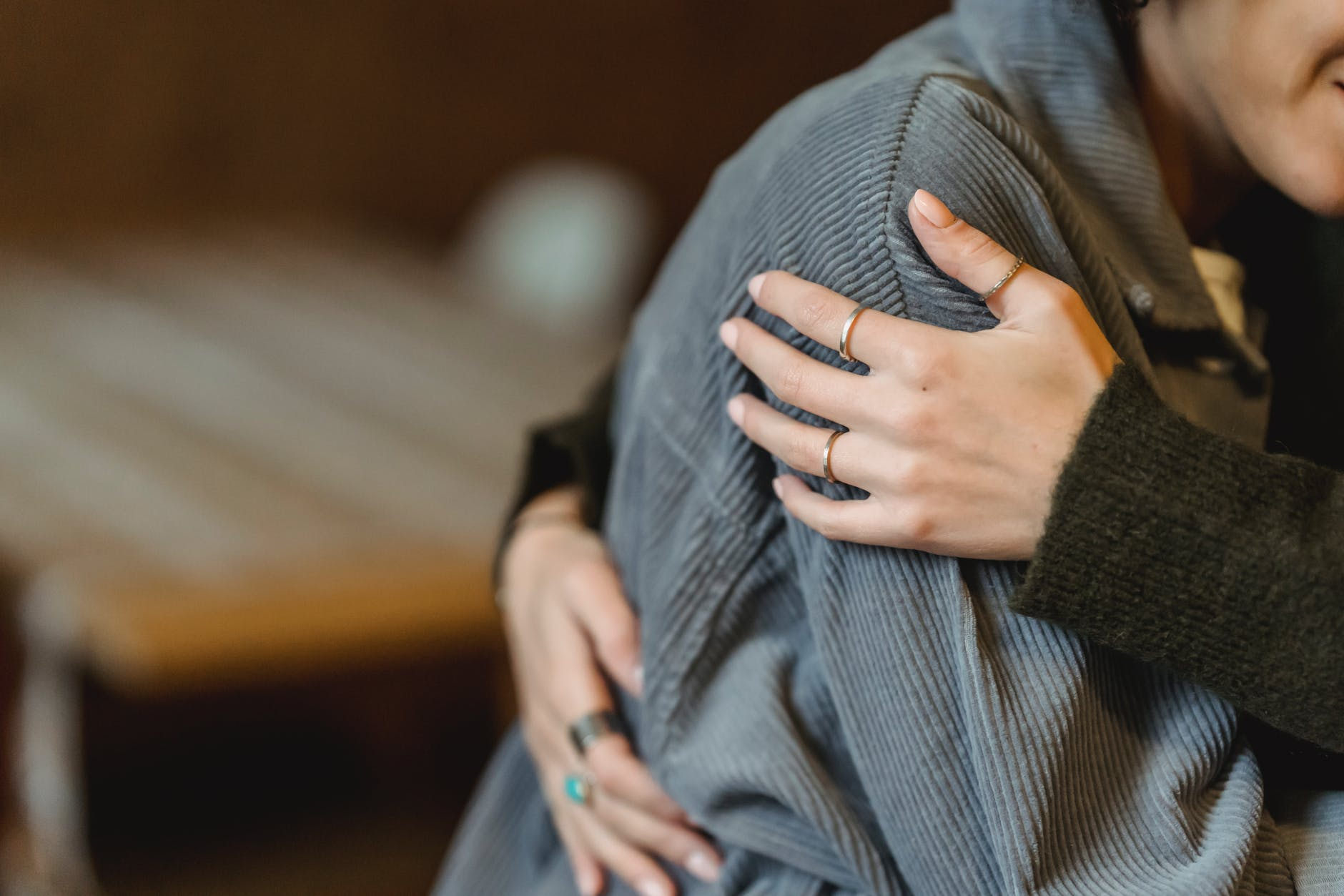 woman comforting desperate girlfriend and embracing gently